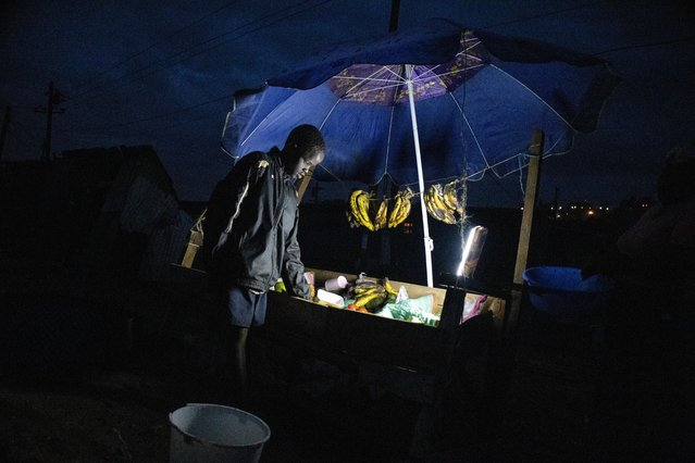 A young boy sells vegetables close by his home moments before the 8 PM curfew on March 29, 2021 in Nairobi City, Kenya. After Kenya announced it's third wave hit of the Corona Virus on March 26, 2021. Across Nairobi Kenyas Capital, life has been uneasy for most residents and small scale business owners who had to close down their businesses and head back to their homes prior to curfew time starting from 8 PM till 4 AM as ordered by President Uhuru Kenyatta as part of measures to tame down the rising number and spread of Corona Virus across the Country. (Photo by Donwilson Odhiambo/Getty Images)