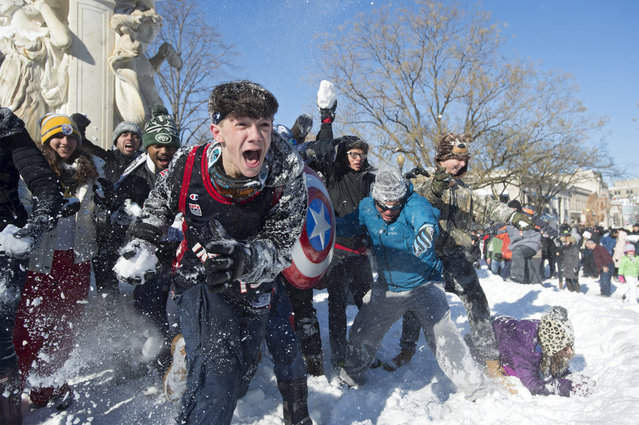 People participate in a snowball fight after this weekend's blizzard, at Dupont Circle in Washington, D.C., Sunday, January 24, 2016. (Photo by Michael Reynolds/EPA)