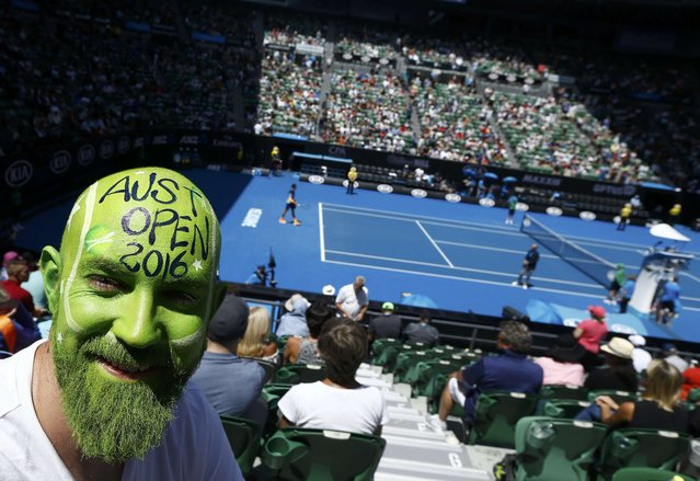 Tennis fan Greg Alexander poses with his face painted on Rod Laver Arena at the Australian Open tennis tournament at Melbourne Park, Australia, January 25, 2016. (Photo by Jason Reed/Reuters)