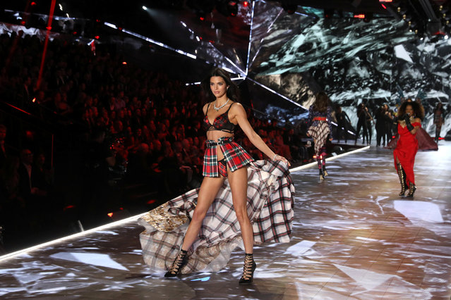 Model Kendall Jenner presents a creation as singer Leela James performs during the 2018 Victoria's Secret Fashion Show in New York City, New York, U.S., November 8, 2018. (Photo by Mike Segar/Reuters)