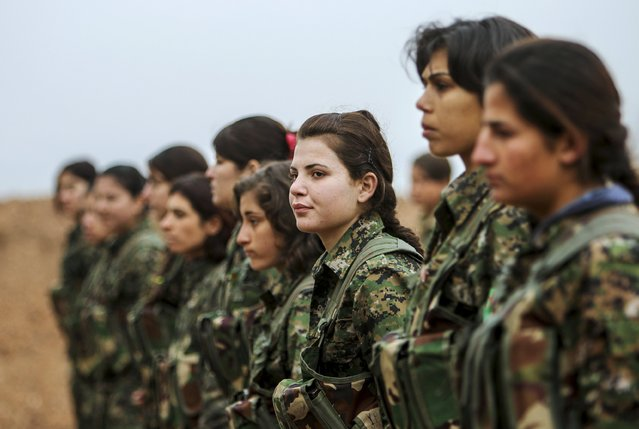 Female fighters of the Kurdish People's Protection Units (YPG) stand at attention at a military camp in Ras a-Ain January 30, 2015. (Photo by Rodi Said/Reuters)