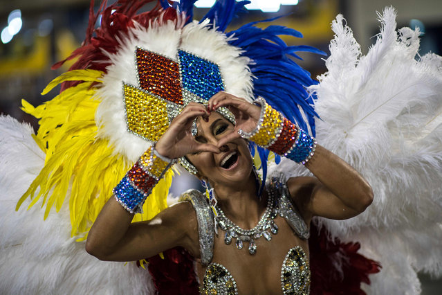 Revellers of Vila Isabel samba school perform during the second night of the carnival parade at the Sambadrome in Rio de Janeiro on february 08, 2016, Brazil. (Photo by Christophe Simon/AFP Photo)