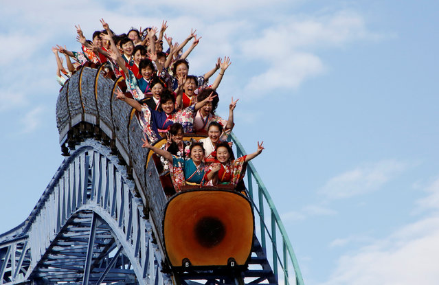 Japanese women wearing kimonos ride a roller coaster during their Coming of Age Day celebration ceremony at an amusement park in Tokyo, Japan January 9, 2017. (Photo by Kim Kyung-Hoon/Reuters)