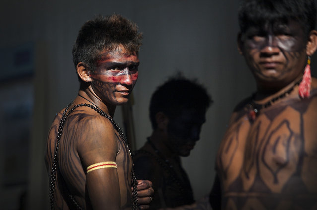 Indigenous men stand watch inside the gates of the Belo Monte Dam's main turbine site. On May 27th, an indigenous group made up of an alliance of indigenous groups occupied the dam and halted construction on the main turbine site. (Taylor Weidman)