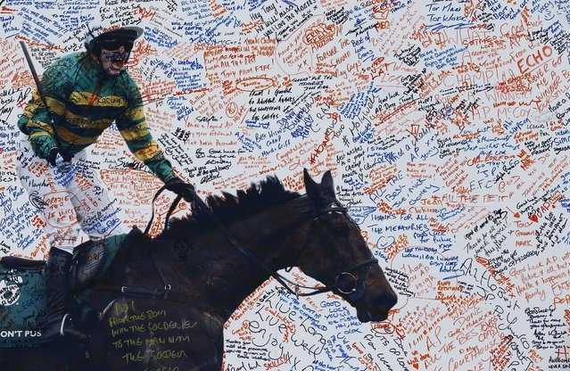 Horse Racing – Crabbie's Grand National Festival – Aintree Racecourse April 10, 2015: Messages are seen on a picture of Tony McCoy on ladies day during the Grand National. (Photo by Darren Staples/Reuters)