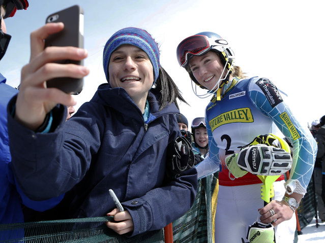 Maria Cavallaro, 14, of North Andover, Mass., snaps a selfie with Mikaela Shiffrin after the skier won the women's slalom ski race at the U.S. Alpine Championships, Saturday, March 28, 2015, at Sugarloaf Mountain Resort in Carrabassett Valley, Maine. (Photo by Robert F. Bukaty/AP Photo)