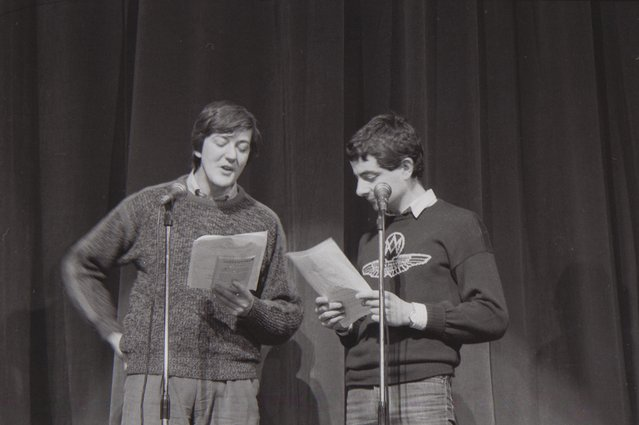 Stephen Fry and Rowan Atkinson on stage in Farmyard Follies, a comedy fundraising show at the London Palladium produced by Charity Projects in support of their own projects and the Home Farm Trust on February 18, 1985 in London, England. (Photo by Comic Relief/Comic Relief via Getty Images)