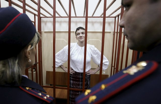 Ukrainian military pilot Nadezhda Savchenko stands inside a defendants' cage as she attends a court hearing in Moscow April 17, 2015. Pro-Russian separatists battling Kiev's forces captured Savchenko last June and handed her over to Moscow, where she is being held on charges of aiding the killing of two Russian journalists in eastern Ukraine. (Photo by Maxim Zmeyev/Reuters)