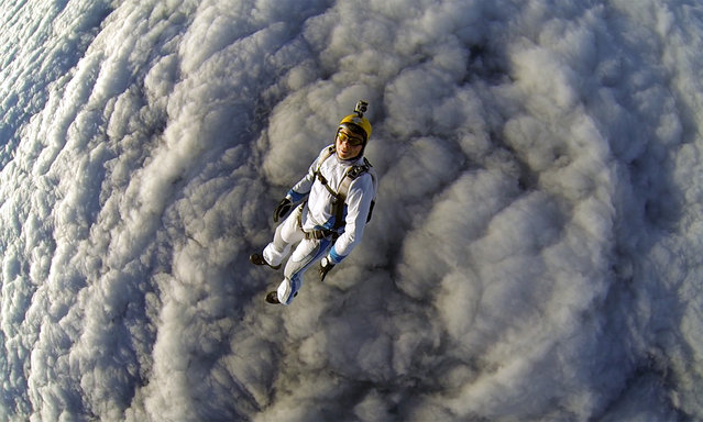 Gleb Vorevodin falling into the fluffy clouds, at the Pushchino airport near the Russian capital Moscow. (Photo by Gleb Vorevodin/Caters News Agency)