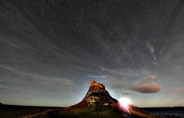 Lindisfarne Castle on Holy Island in Northumberland, the morning after a disappointing night for star gazers as they were unable to see the aurora borealis, also known as the northern lights, from this location, on January 10, 2014. (Photo by Owen Humphreys/PA Wire)
