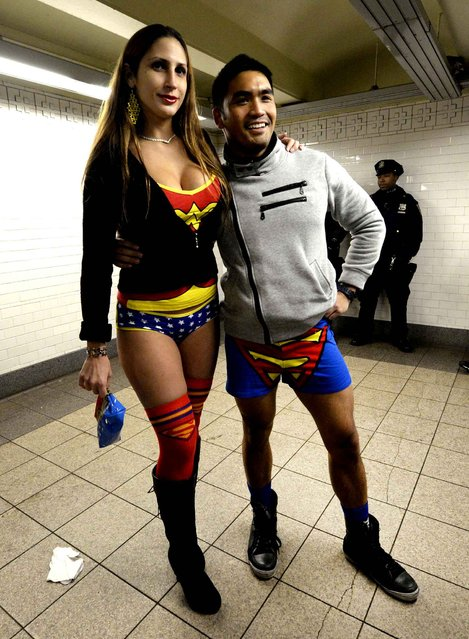 Two riders in the New York City subway in the underwear as they take part in the 2014 No Pants Subway Ride January 12, 2014. (Photo by Timothy A. Clary/AFP Photo)