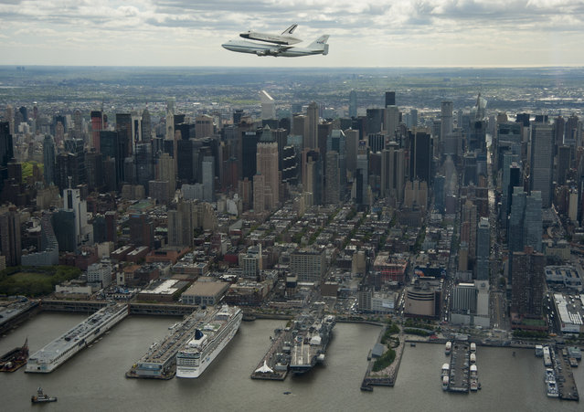 This photo provided by NASA shows space shuttle Enterprise, mounted atop a NASA 747 Shuttle Carrier Aircraft (SCA), flying near the Intrepid Sea, Air and Space Museum on April 27, 2012, in New York. (Photo by Robert Markowitz/AFP Photo/NASA)