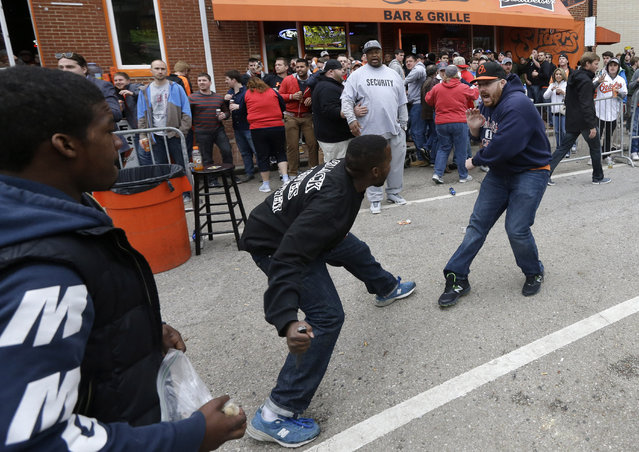 Protestors confront a patron outside of a bar across the street from Oriole Park at Camden Yards after a rally for Freddie Gray, Saturday, April 25, 2015, in Baltimore. (Photo by Patrick Semansky/AP Photo)