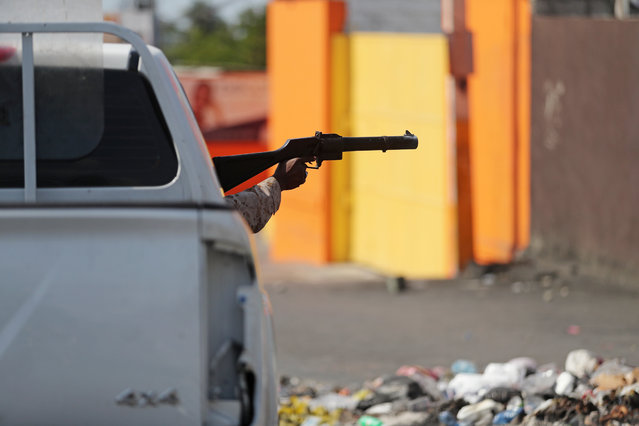 A police officer aims a weapon at demonstrators (not pictured) during anti-government protests in Port-au-Prince, February 15, 2019. (Photo by Ivan Alvarado/Reuters)