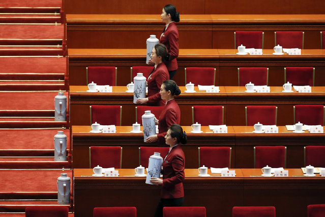 Attendants serve tea at the Great Hall of the People during the second plenary session of the National People's Congress (NPC) in Beijing, China, March 9, 2016. (Photo by Kim Kyung-hoon/Reuters)