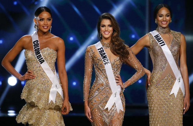 Andrea Tovar of Colombia, left, Iris Mittenaere of France, center, and Raquel Pelissier of Haiti, pose shortly after being declared the top three finalists in the Miss Universe 2016 coronation Monday, January 30, 2017, at the Mall of Asia in suburban Pasay city, south of Manila, Philippines. Iris Mittenaere was crowned the Miss Universe 2016 while Raquel Pelissier was the runner-up. (Photo by Bullit Marquez/AP Photo)