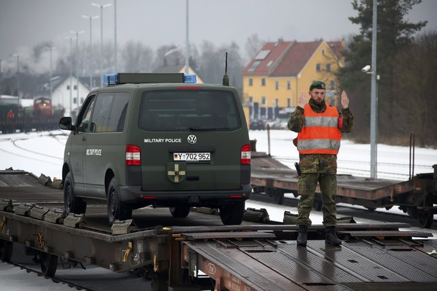 German armed forces Bundeswehr soldiers load their vehicles on a train in Grafenwoehr, Germany January 31, 2017, before deployment for NATO duty in Lithuania. (Photo by Michael Dalder/Reuters)