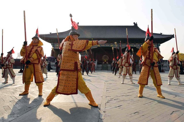 Performers dressed in costumes of the Qing Dynasty (AD 1644–1911) rehearse the ancient royal heaven worshiping ceremony for the upcoming Lunar New Year or Spring Festival at the Temple of Heaven in Beijing on January 29, 2014. The sacred ceremony is a unique performance to replicate the proceedings carried out in the Qing Dynasty by emperors to pray for peace and prosperity of the nation. (Photo by AFP Photo)