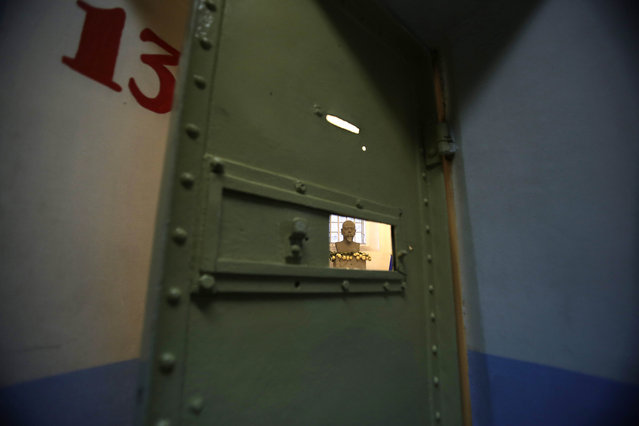 This April 7, 2015 photo shows a bust of Eloy Alfaro, who was Ecuador's president from 1897-1901 and again from 1906-1911, behind a jail cell at the now empty Garcia Moreno prison where he was imprisoned, during a guided tour for the public in Quito, Ecuador. (Photo by Dolores Ochoa/AP Photo)