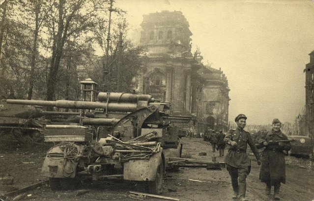 Russian soldiers are pictured next to the Reichstag building in this undated photo taken May 1945 in Berlin. Some 70 years on from the Battle for Berlin, instrumental in the end of World War II, Reuters photographer Fabrizio Bensch unearthed pictures by Red Army photographer Georgiy Samsonov, showing his portrayal of a city laid siege. (Photo by Georgiy Samsonov/Reuters/MHM)