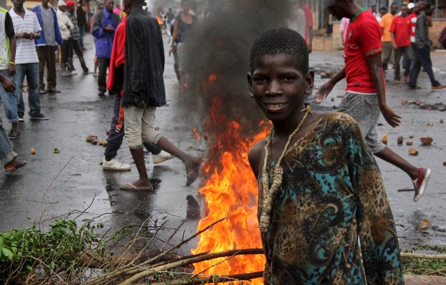 A protester poses for a photograph as they barricade a road to demonstrate against plans by Burundian President Pierre Nkurunziza to run for a third five-year term in office, in Bujumbura, May 8, 2015. (Photo by Jean Pierre Aime Harerimana/Reuters)