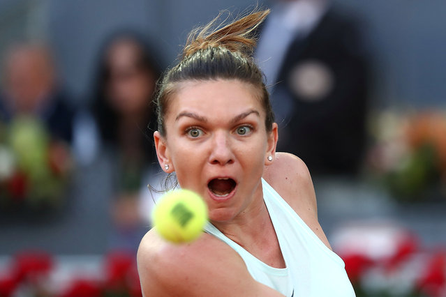 Romania's Simona Halep returns the ball to Netherlands' Kiki Bertens during their WTA Madrid Open final tennis match at the Caja Magica in Madrid on May 11, 2019. (Photo by Sergio Perez/Reuters)