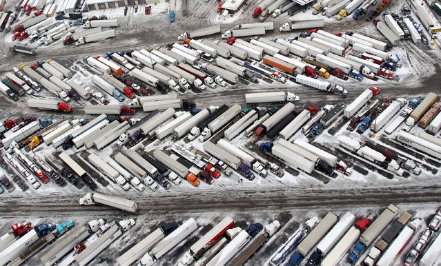 In this aerial photo taken on March 3, 2014, semitrailers fill up a truck stops in West Memphis, Ark. Some motorists on the highway in eastern Arkansas were stranded overnight due to lingering icy conditions from a weekend winter storm. An Arkansas highway department spokesman said Tuesday that traffic can't get moving consistently because of repeated accidents. (Photo by Mike Brown/AP Photo/The Commercial Appeal)