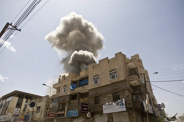 Smoke rises from a house of former Yemeni president Ali Abdullah Saleh after a Saudi-led airstrike in Sanaa, Yemen, Sunday, May 10, 2015. (Photo by Hani Mohammed/AP Photo)