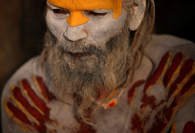 A Hindu holy man, or sadhu, smeared with ashes sits at the premises of Pashupatinath Temple, ahead of the Shivaratri festival in Kathmandu, Nepal February 21, 2017. (Photo by Navesh Chitrakar/Reuters)