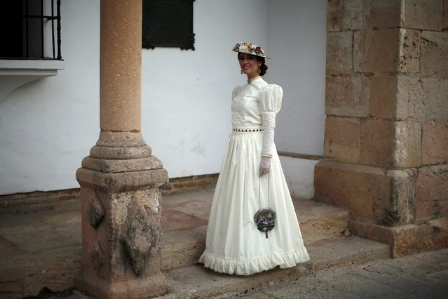 "Maria Dolores Perez Clotet, 37, dressed as a bourgeois, poses for a photo as she participates in the third edition of ""Ronda Romantica"" (Romantic Ronda) in Ronda, southern Spain, May 16, 2015. (Photo by Jon Nazca/Reuters)"