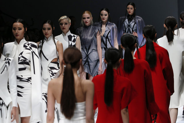 Models show creations from J BY HO & WOW-IN at China Fashion Week in Beijing, China, March 29, 2016. (Photo by Kim Kyung-Hoon/Reuters)