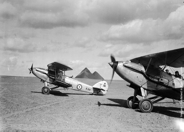 1937: RAF fighting planes landing in Cairo in front of the pyramids
