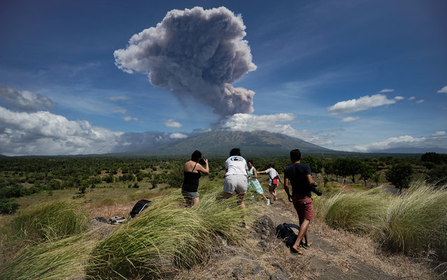 A plume of ash is released as Mount Agung volcano erupts, seen from the Kubu subdistrict in Karangasem Regency on Indonesia's resort island of Bali on May 31, 2019. (Photo by Made Alit Suantara/AFP Photo)