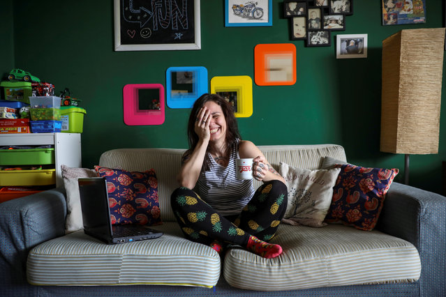 """Ivana, 32, a community manager, smiles in her home where she works in Belgrade, Serbia, February 21, 2017. """"Mainly you can see these (gender) gaps in state companies, which are relics of socialism. It is that standard belief where women are """"the best"""" at being secretaries"""", Ivana said. (Photo by Marko Djurica/Reuters)"""