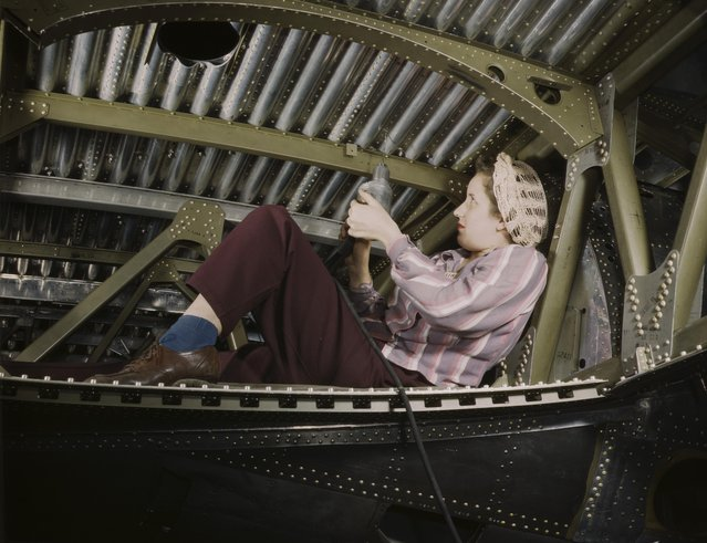 An A-20 bomber being riveted by a woman worker at the Douglas Aircraft Company plant at Long Beach, California, 1942. (Photo by Alfred T. Palmer/Buyenlarge/Getty Images)