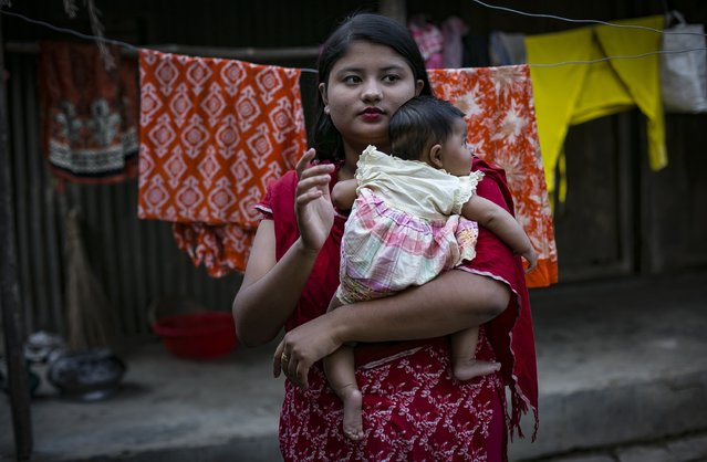 Meghla holds her baby on March 7, 2017 in Khulna division, Bangladesh. (Photo by Allison Joyce/Getty Images)
