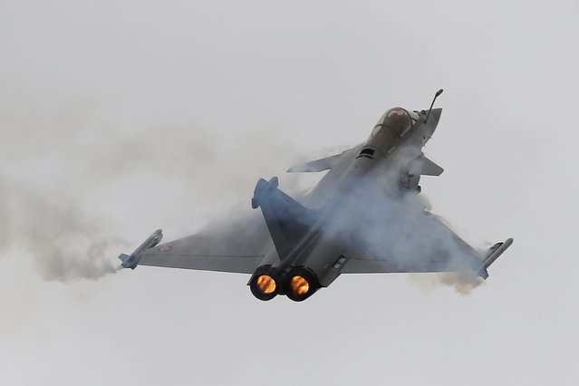 "French Capt. Benoit Planche, nicknamed ""Tao"", performs with a Rafale single seat jet aircraft during a demonstration flight at the Paris Air Show, in Le Bourget airport, north of Paris, Thursday, June 18, 2015. Some 300,000 aviation professionals and spectators are expected at this week's Paris Air Show, coming from around the world to make business deals and see dramatic displays of aeronautic prowess and the latest air and space technology. (AP Photo/Francois Mori)"