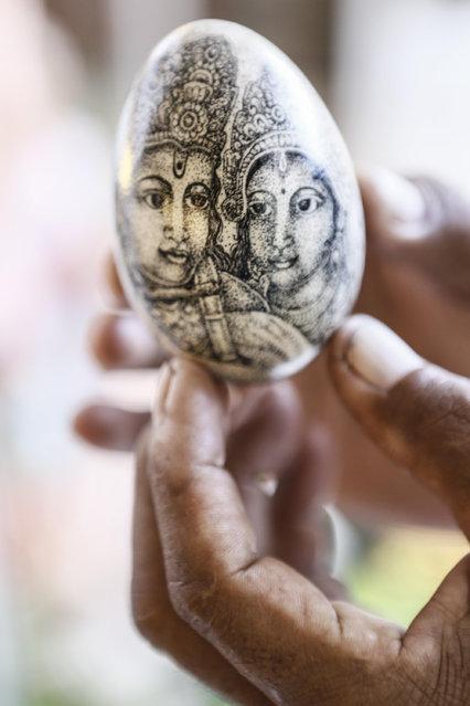 Wayan Sadra shows his exclusive painted eggs at his workshop on April 14, 2014 in Sukawati, Gianyar, Bali, Indonesia. (Photo by Putu Sayoga/Getty Images)