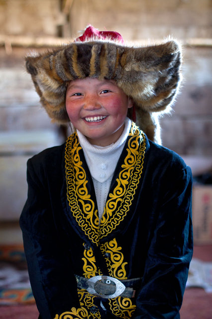 13 year old Ashol Pan. These stunning photographs show the changing face of a majestic centuries old Kazakh pastime tradition  that still lives in the lands of mongolia – eagle hunters. (Photo by Asher Svidensky/Caters News)