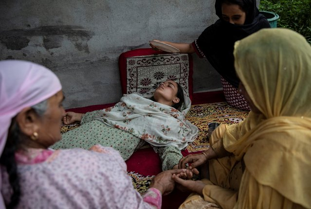 Bilquis, sister of Irfan Ahmad Hurra, who according to the relatives was arrested during a clampdown after the scrapping of the special constitutional status for Kashmir by the government, is attended by her relatives after she fainted while crying as she mourns inside their house, in Pulwama, south of Srinagar, August 13, 2019. (Photo by Danish Siddiqui/Reuters)