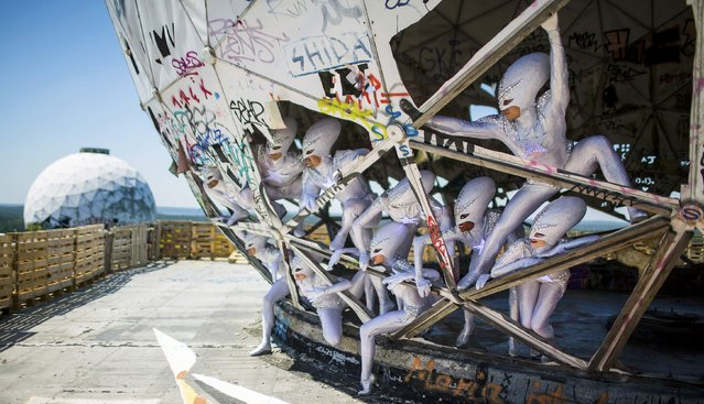 """Dancers of the Friedrichstadt-Palast from the show """"THE WYLD"""" pose during a promotional photocall at a former National Security Agency (NSA) listening station at the Teufelsberg (Devil's Mountain) in Berlin, Germany, July 2, 2015. The 10.6 million euro ($13.5 million) show is the largest production budget in the 95-year history of Friedrichstadt-Palast. (Photo by Hannibal Hanschke/Reuters)"""