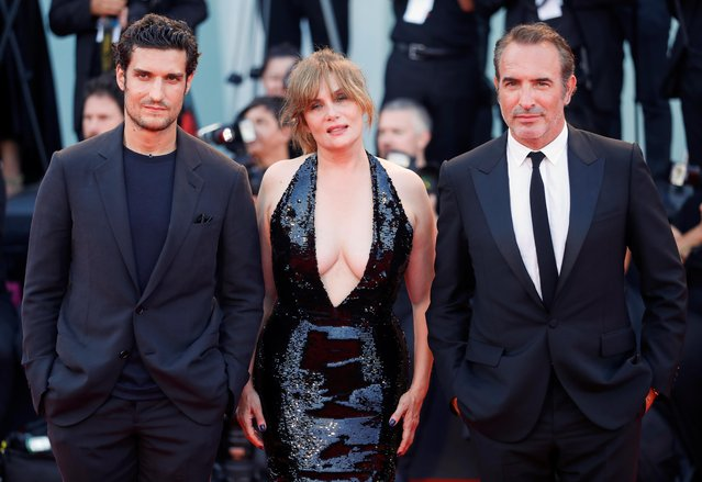 "Actors Jean Dujardin, Emmanuelle Seigner and Louis Garrel pose on the red carpet for the screening of the film ""An Officer and a Spy"" during the 76th Venice Film Festival at Sala Grande on August 30, 2019 in Venice, Italy. (Photo by Yara Nardi/Reuters)"