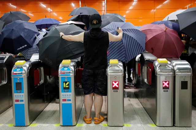 Anti-extradition bill protesters open umbrellas as they demonstrate at a Mass Transit Railway (MTR) station, at Po Lam, in Hong Kong, China on September 4, 2019. (Photo by Tyrone Siu/Reuters)