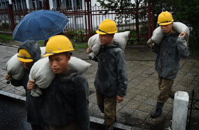 Workers on the streets in Pyongyang, North Korea on May 6, 2016. (Photo by Linda Davidson/The Washington Post)