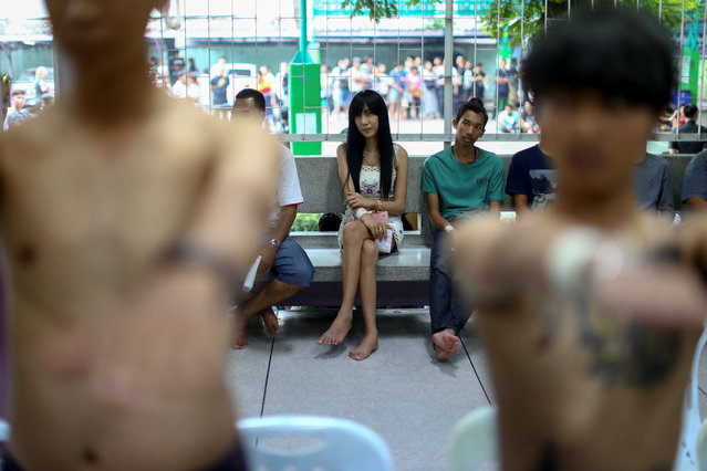 Kanphitcha Sungsuk, 21, waits for a health examination during an army draft held at a school in Klong Toey, the dockside slum area in Bangkok, Thailand, April 6, 2017. (Photo by Athit Perawongmetha/Reuters)