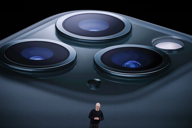 CEO Tim Cook presents the new iPhone 11 Pro at an Apple event at their headquarters in Cupertino, California, U.S. September 10, 2019. Apple has revealed the new iPhone 11 and new products and services at their annual launch event, as the tech giant reaches a turning point where it focuses as much on services as its hardware and software. Apple revealed that its new iPhone 11 will come with two 12 megapixel back cameras, including an ultra wide-angle lens and the next generation of microchips, the A13. The Apple 11 Pro (pictured) will have three cameras on the back – wide angle, telephoto and ultra-wide. It can create videos with all three back cameras and the front camera at the same time. (Photo by Stephen Lam/Reuters)