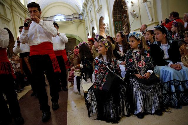 """Maya"" girls and their assistants look at musicians play at San Lorenzo church during ""Las Mayas"" festivity in Madrid, Spain, May 8, 2016. (Photo by Susana Vera/Reuters)"