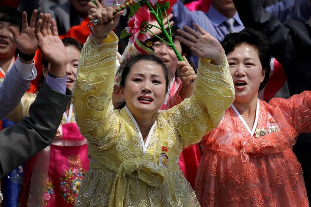 A North Korean woman cries as she looks towards her country's leader Kim Jong Un during a military parade on Saturday, April 15, 2017, in Pyongyang, North Korea to celebrate the 105th birth anniversary of Kim Il Sung, the country's late founder and grandfather of current ruler Kim Jong Un. (Photo by Wong Maye-E/AP Photo)