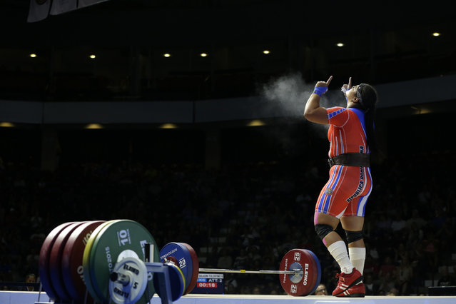 Dominican Republic's Veronica Saladin Tolentino celebrates after a successful lift attempt during the women's +75kg weightlifting competition at the Pan Am Games in Oshawa, Ontario, Wednesday, July 15, 2015. (Photo by Felipe Dana/AP Photo)