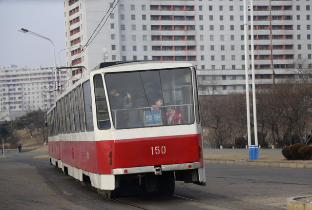 In this Saturday, February 2, 2019, photo, people ride on a tram in Pyongyang, North Korea. Pyongyang is upgrading its overcrowded mass transit system with brand new subway cars, trams and buses in a campaign meant to show leader Kim Jong Un is raising the country's standard of living. (Photo by Dita Alangkara/AP Photo)